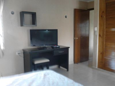 Small internet table with flat screen TV connected to Dish Satellite