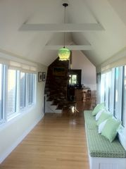 Wellfleet house photo - Hallway from kitchen to living room, 9 foot bench to relax on