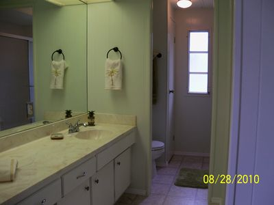 Master Bathroom has tub/shower combo with large sink area.