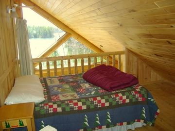 Second bedroom in loft; also open to main living area and beautiful view of lake