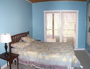 Blue Ridge cabin photo - One of three downstairs bedrooms with queen bed