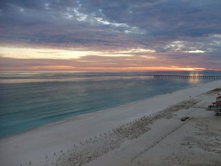 Pensacola Beach condo photo - Enjoy the beautiful evening watching the sunset from our balcony