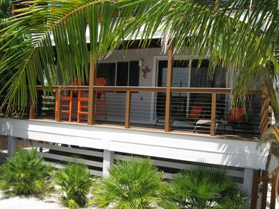 Your private deck with a cover of coconut trees