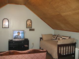 Fayetteville house photo - Two twin beds and Dish T.V. in Game Room above Master Bedroom