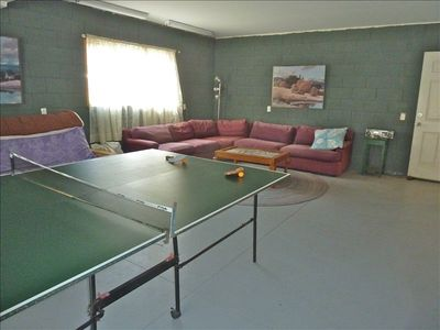 Rec Room with ping pong, card table and games.  Large sitting area.