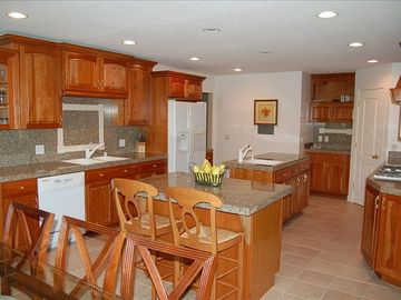 Huge kitchen with granite countertops, 2 islands, 2 sinks and all new cabinets