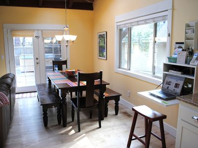 Dining table seats 8-10 and french doors open to private deck with hot tub.