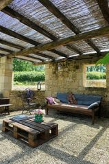 Naujan-et-Postiac farmhouse photo - Outdoor lounge area with stone sink and bbq (hidden).