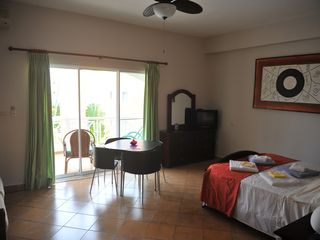 Punta Cana studio photo - view of air-conditioned studio showing ceiling fan, cable tv w/balcony