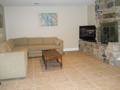 Den with cable TV and gas fireplace