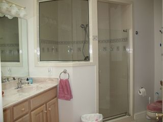 Main Level Master Bath w/ shower, double vanity, toilet - Lake Anna house vacation rental photo