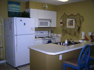 Orange Beach condo photo - Kitchen, Fully Equipped, Dishes, Cookware, D/W, Icemaker, Microwave