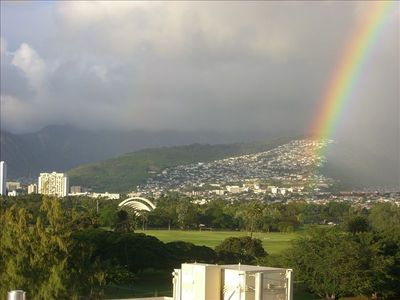 A rainbow over the bandshell in Kapiolani Park as seen from the living room.