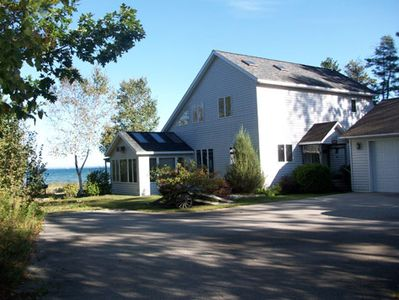 Cheboygan cottage rental - View of the back of the cottage. Beautiful Lake Huron just steps away!