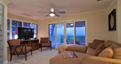 Designer Furnished Living Room With Beach View & Flat Screen TV
