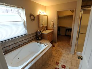 Estes Park condo photo - Aspen Grove master bath with Jacuzzi tub and large walk-in shower
