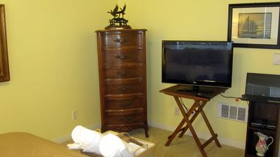 bedroom chest of drawers, with brand new flat screen T.V. DVD Player in bookcase