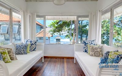 Upstairs lounge with large windows that open up to the sea...