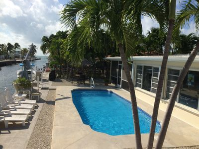 Swaying palms, pool, patio,  canal, ocean, PARADISE