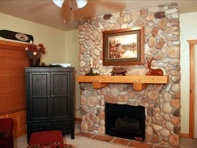 Branson cabin rental - Sit by the Fireplace or Open Up the Entertainment Center