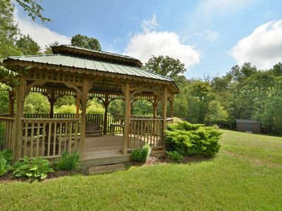Gazebo with table and benches, plus a swing to relax. Electricity in gazebo.