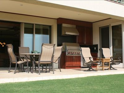 Wrap-around lanai with built-in BBQ, sink and fridge for your outdoor enjoyment.