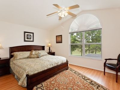 2nd MASTER BEDROOM with KING BED and BACKYARD view