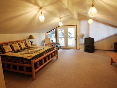 Spacious Master Suite and sitting room with balcony overlooking lake