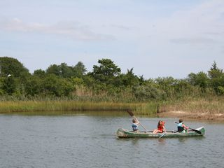East Quogue house photo - View of creek and children on canoe paddling to Treasure Island.