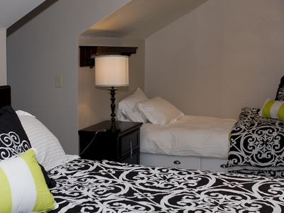 This guest room is spacious and set up to accommodate three in the King and Twin beds.