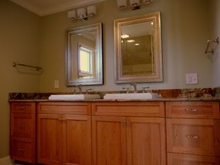 Kiawah Island villa photo - Custom cherry cabinets grace the master bathroom at Double Dunes west side