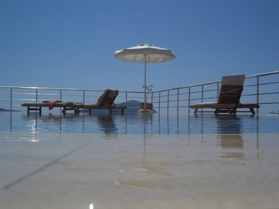 Kalkan villa rental - Pool area with view of Kalkan beyond