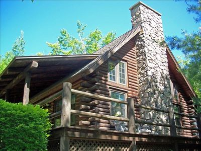 Side View of Cabin with deck and stone fireplace
