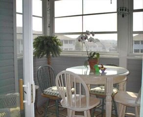 Rehoboth Beach condo photo - The sun room overlooks the pond. Birds in the a.m.