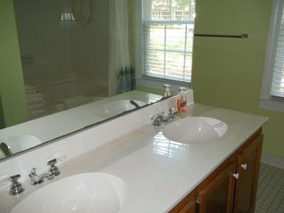 Murrells Inlet cottage photo - Master bath with oversized tub/shower combo. Towels provided.