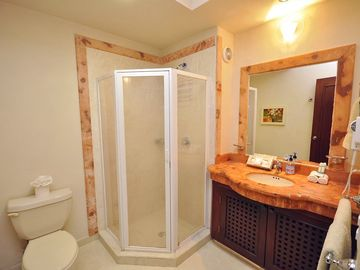Two bathrooms with granite countertops