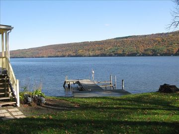 View of the large L-shaped dock and beautiful lake and bluff views.