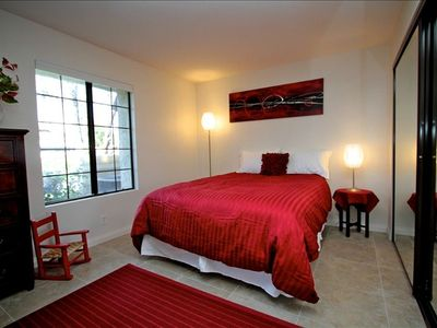 "The comfy queen bed in this stunning ""red"" room is the perf..."