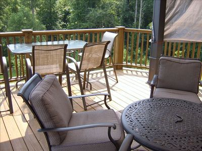 "The deck has a large 10""x12"" canopy, 4 club chairs, table & 6 bar level chairs"