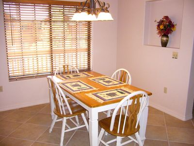 Dining Table plus seating for four at kitchen counter