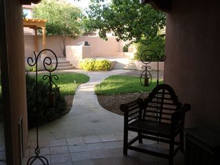 Albuquerque house photo - Follow the path to the terraced pergola, fireplace, and grill area.