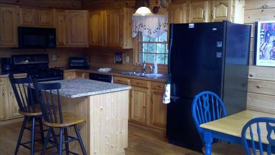A very pleasant kitchen, great light, marble island counter top, breakfast bar