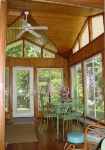 Main house sunroom is a refreshing retreat for reading or friendly gatherings