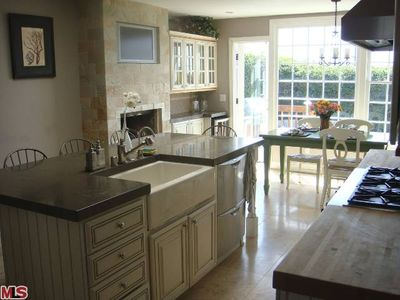 Kitchen with built in flat screen tv and gas fireplace