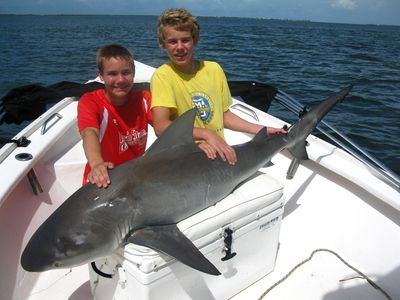 An exciting July day for 14 year olds..a 100 lb. bull shark, released, of course