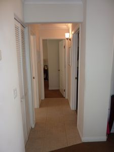 Hallway to two bedrooms and bathroom.