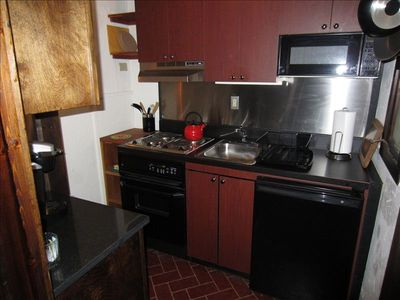 Kitchen with all new appliances; New 4 burner Stove, Microwave,Refrig,...