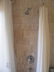 Maldonado farmhouse photo - BATHROOM SHOWER, TRAVERTINE MARBEL.