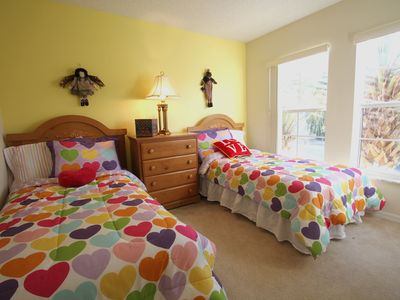 Lovely Twin Bedroom with Girl's Decor & Extra Neutral Color Blankets