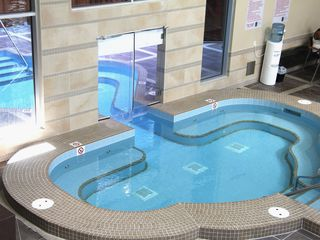 Canmore condo photo - Indoor/outdoor hot tub